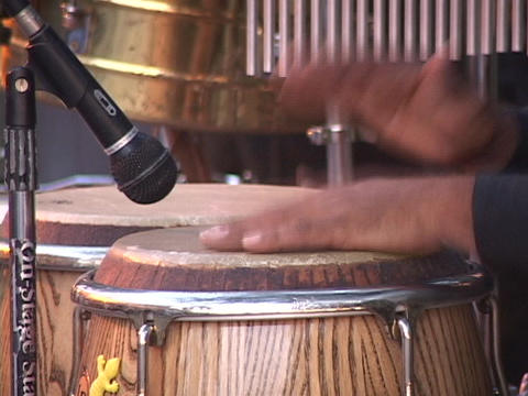 A man's hands play a set of bongo drums Stock Video Footage