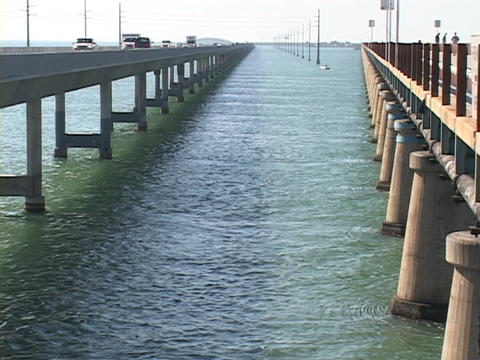 Traffic travels on the bridges or skyway in the Florida Keys Stock Video Footage