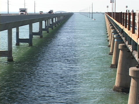 Traffic travels on the bridges or skyway in the Florida Keys Live Action