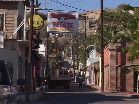 A few pedestrians walk a street in a rural town in Mexico Footage