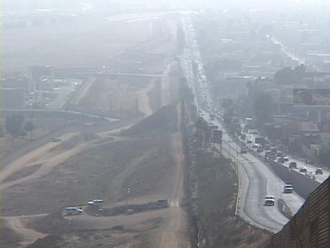 Traffic flows both ways across the U.S. Mexico border in... Stock Video Footage