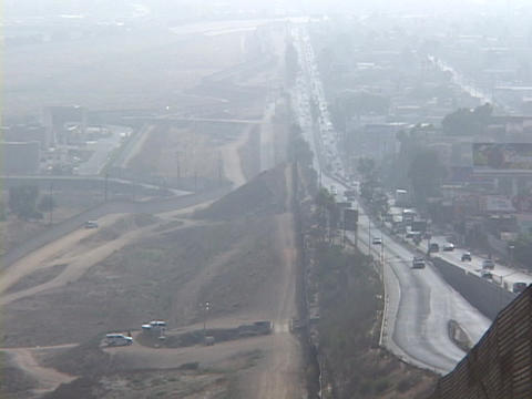 Traffic flows both ways across the U.S. Mexico border in San Diego, California Footage