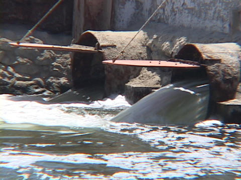 Water pollution, sewage or dirty water flows through... Stock Video Footage