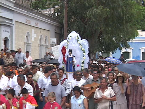 People march in a Catholic Christian procession or... Stock Video Footage