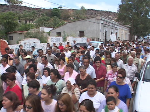 Crowds of people walking through small Mexico village,... Stock Video Footage