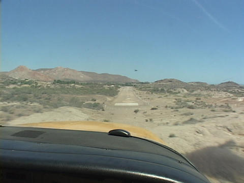 A small plane lands on a dirt runway in Mexico Stock Video Footage
