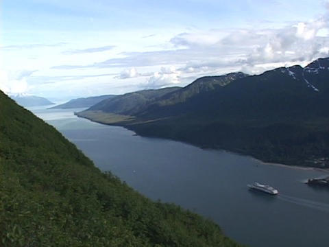 A cruise ship travels in an Alaskan fjords Stock Video Footage