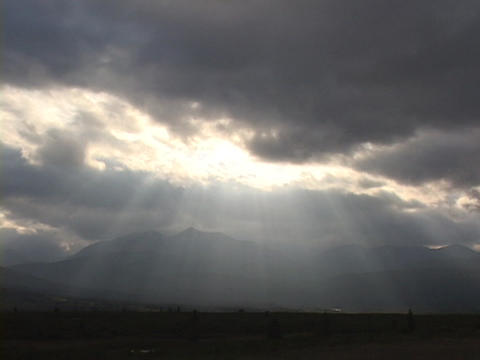 Rays of light filter out of heavy clouds Stock Video Footage