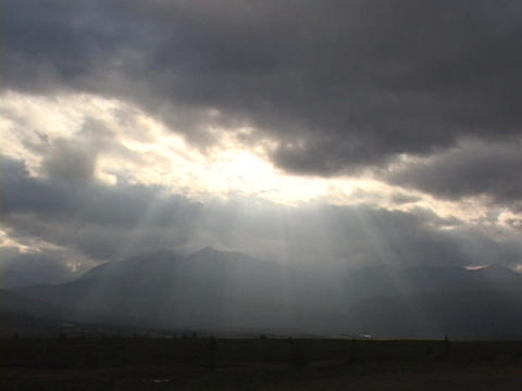 Rays of light filter out of heavy clouds Footage