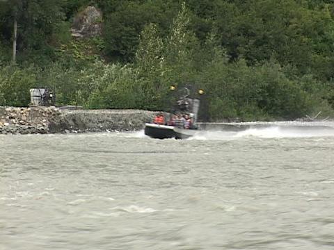 Passengers ride in a fan boat that zips along an Alaskan... Stock Video Footage