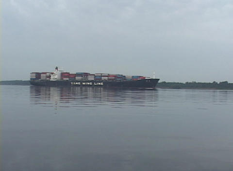 A large trash barge floats slowly across the water Stock Video Footage