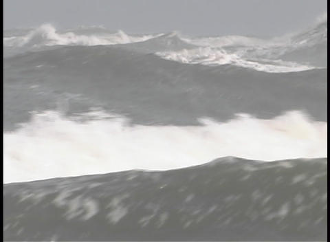 Violent waves whitecap as they roll across the ocean Stock Video Footage