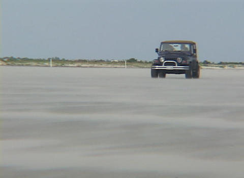 A jeep drives through a low dust storm Stock Video Footage