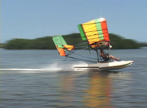 An ultralight airplane skids across the water and begins... Stock Video Footage