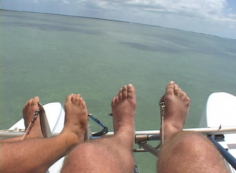 Passengers in an ultralight airplane fly above the ocean Footage
