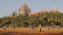 Bombay High Court with people playing cricket on Oval Maidan,Mumbai,India Footage