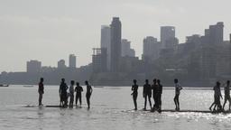 Kids playing on chowpatty beach,Mumbai,India Footage