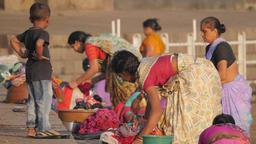 Kid watching women washing clothes at Godavari ghat,Nashik,India Footage