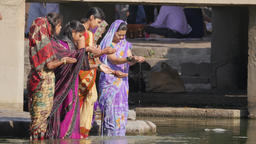 Women praying on Ram Kund ghat at sacred Godavari river,Nashik,India Footage