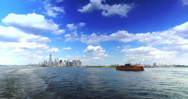 Skyline of Lower Manhattan with Staten Island Ferry in the Foreground Footage