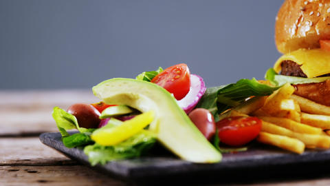 Snacks and salad on slate board Live Action