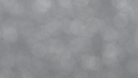 Subtle Rotating Silver Bokeh Animation