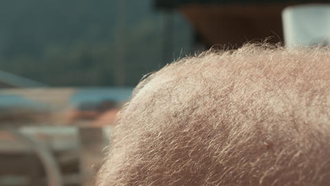 Close-up partial view of hairy male knee outdoor Live Action