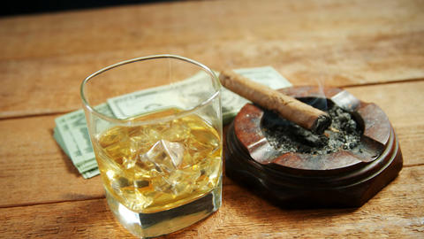 Ashtray, cigar, whisky and US dollars on table 4k Live Action