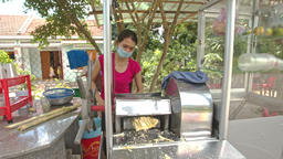 Woman Makes Sugar-cane Juice with Machine in Street Footage