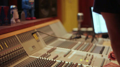 Music industry large recording studio mixing desk with sound engineer Footage