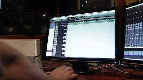 Computer screens in a music recording studio running mixing software Footage