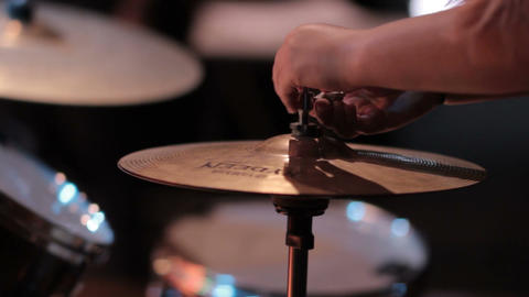 Setting up a drum kit equipment for drummer of a band in music recording studio Footage