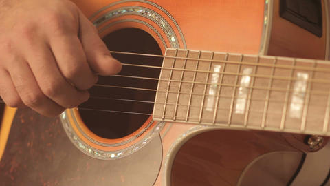 Guitar close up of fingers on strings in an audio music recording studio Live Action