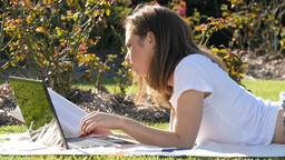 Intellectual diligent student woman studying outdoors on laptop computer Footage