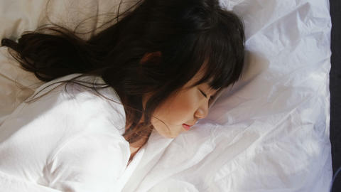 Girl sleeping on the bed in bed room 4k Live Action