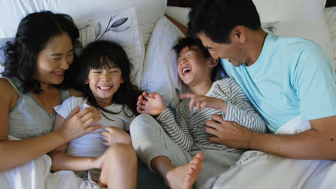 Happy family having fun on bed in the bed room 4k Live Action