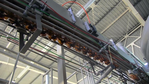 Plastic bottles in production line Live Action