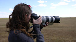 Female photographer with telephoto lens Live Action