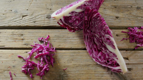 Red cabbage on wooden table 4k Live Action