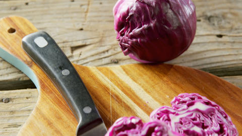 Red cabbage with knife on chopping board 4k Live Action