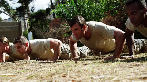 Military soldiers dosing push-ups during obstacle course 4k Live Action