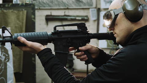 Man trains to shoot at the shooting range Live Action