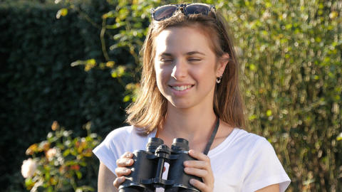 Millennial woman with binoculars searching looking into the future of her life Footage