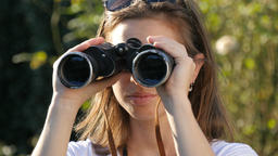 Women searching information holding binocular looking at future prospects Footage