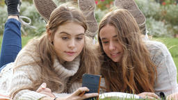 Two young woman funny expression faces at mobile phone camera technology Footage