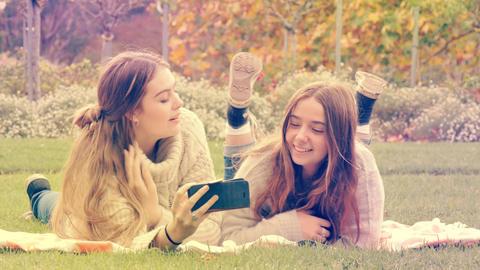 Teenage girls enjoying taking selfie on mobile smart phone technology Footage