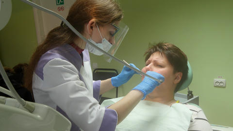 Dentist Curing A Female Patient 4k Footage