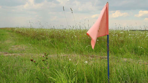 Color flag on field, signal flag for landing field airplanes Stock Video Footage