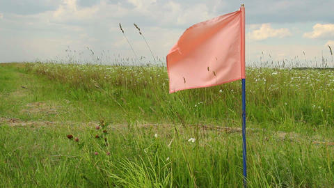 Color flag on field, signal flag for landing field airplanes Footage