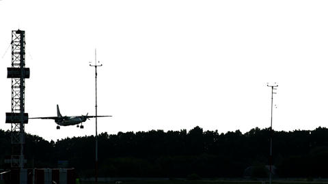 Dusk landing at airport. Aircraft lowers to land wireframe tower Live Action